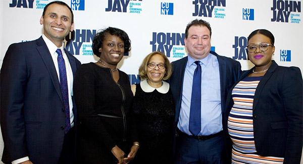 (left to right) Muhammad U. Faridi, Dr. Teresa A. Booker, President Karol V. Mason, Mark Deskovic