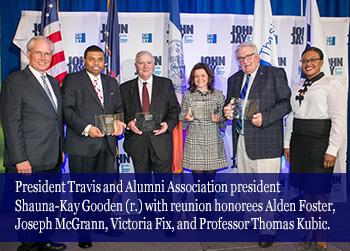 President Travis and Alumni Association president Shauna-Kay Gooden (r.) with reunion honorees Alden Foster, Joseph McGrann, Victoria Fix, and Professor Thomas Kubic.
