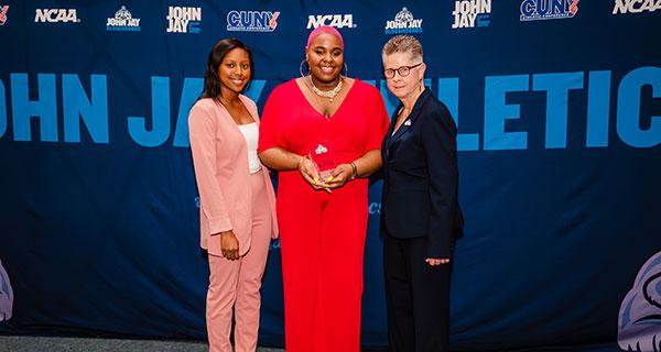 Cheerleading head coach Alyssa Catasus, Ayanna Miller-Smith '19 and Carol Kashow