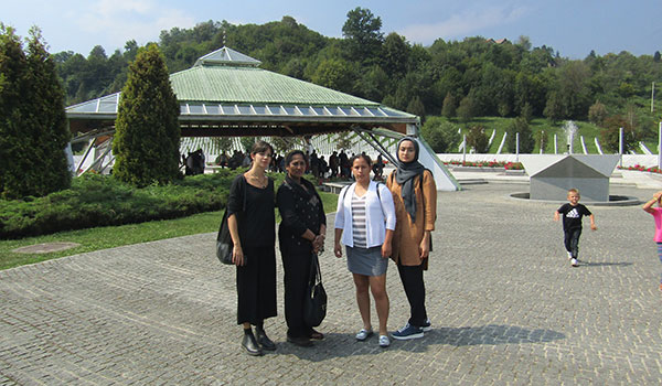 John Jay students and Professor Natarajan at the Srebrenica Memorial