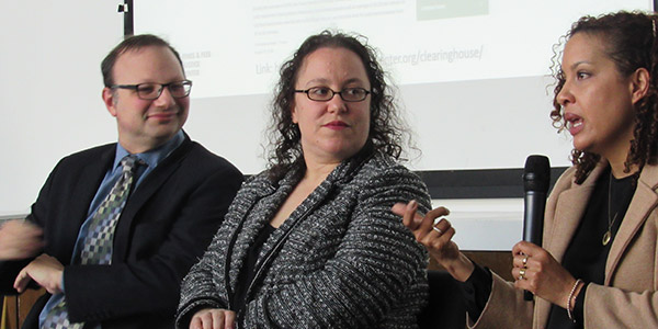 (left to right) Panelists Marc A. Levin and Joanna Weiss watch as Alexes Harris speaks during the panel