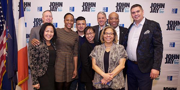 President Karol Mason posing with big group at Champions of Justice 2019
