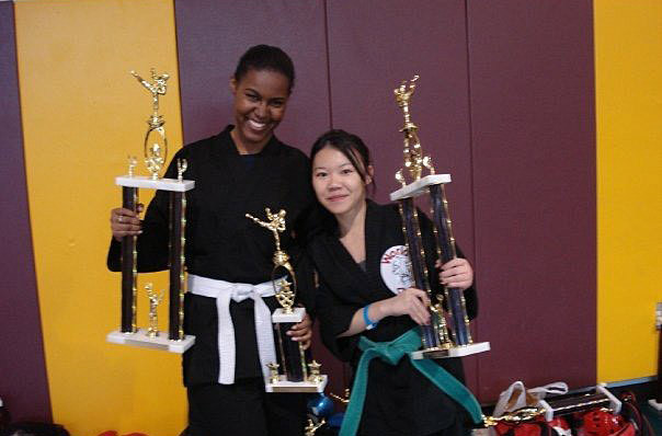 Chen (right) holds up a trophy following a karate tournament
