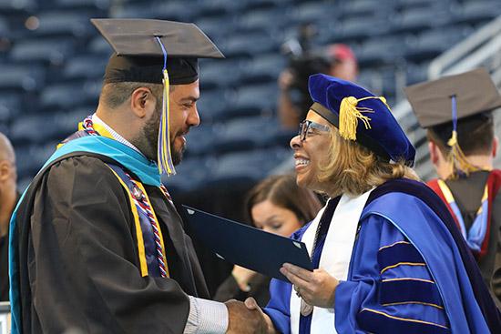 President Mason congratulating the graduates