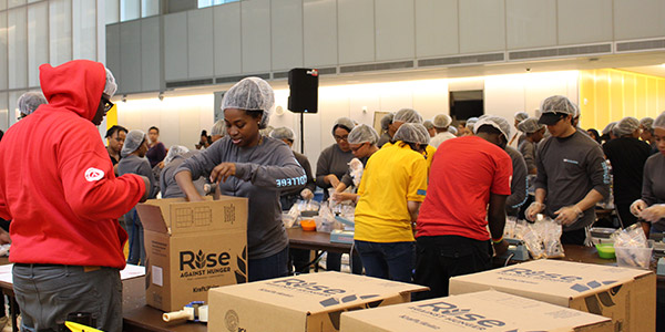 Students boxing up meals in partnership with Rise Against Hunger