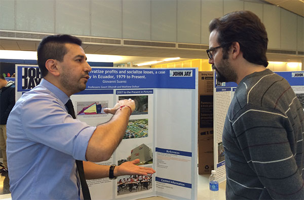 (left to right) Student Giovanni Suarez discussing his research, on how Neoliberalism privatizes profits and socializes losses in Ecuador, with Professor Ian Seda-Irizarry.