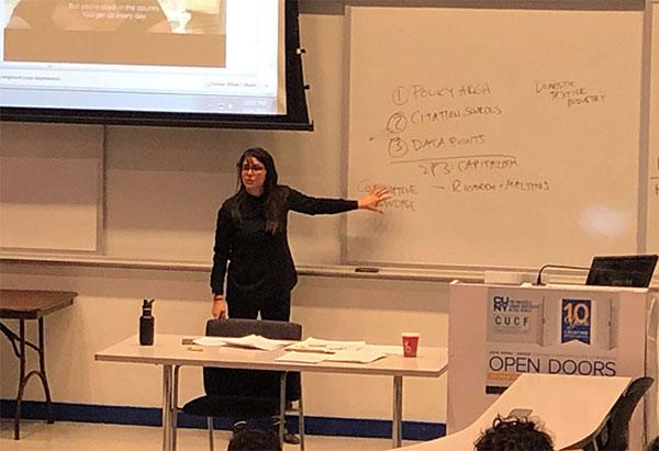 Economics Professor Sara Bernardo teaching.