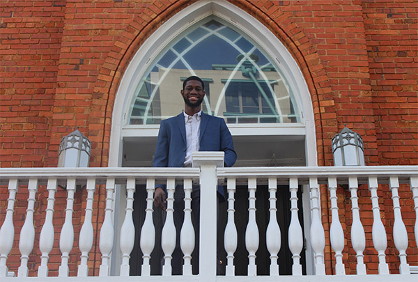 Boodha standing on the balcony of the Dexter Avenue King Memorial Baptist Church—the church where Dr. Martin Luther King, Jr. led his congregation and dreamed of brighter days.
