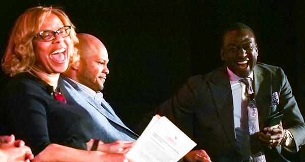 President Mason shares a laugh with the panel