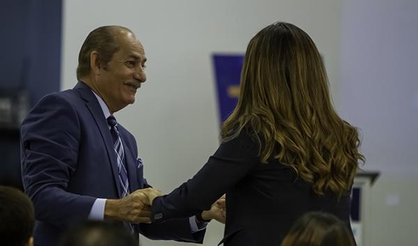 Linares greeting Assemblywoman Cruz