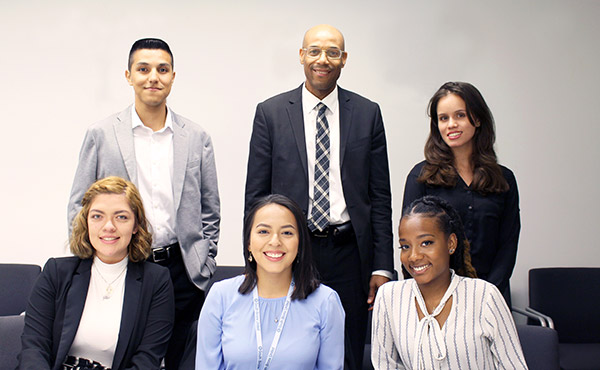 Ronald Day (top row, center), who graduated with his Doctorate from the CUNY Graduate Center/John Jay program in Criminal Justice, with ACE students and alumni