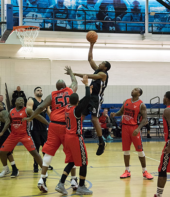 A Bronx Bomber player making a jump shot