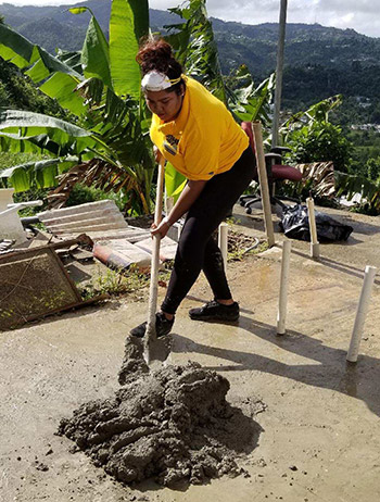 Yesmine helps with the clean up effort at Sandra's house