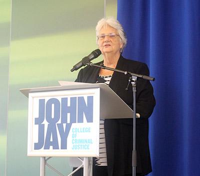 Ann Jacobs speaking to the graduates