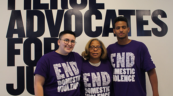President Karol Mason with two John Jay students