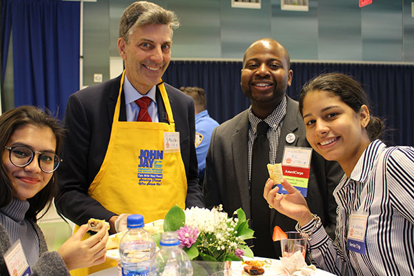 Steve Titan, Vice President for Finance having a moment with Al Edouard, Paula Melendez, and Anily Rozario