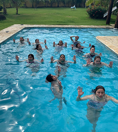 The week-long training included team workouts at the beach and in the pool.