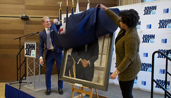 Beshar and Brown unveiling Travis' portrait