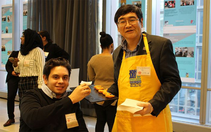 Provost Yi Li serving Matheos Carvalho De Godoy