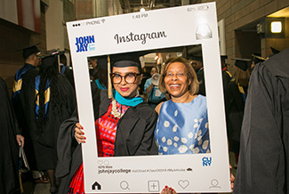 "President Mason having some ""Instagram fun"" at the 2018 graduation ceremony"