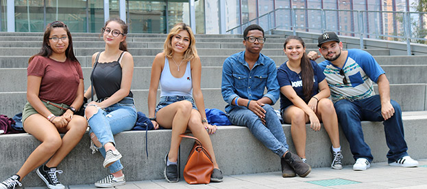 John Jay students sitting on the steps on the Jay Walk