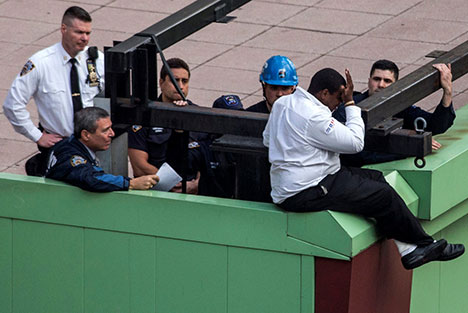 Lt. Jack Cambria of the NYPD Hostage Negotiation Team, and instructor for the EDP program talking a distraught man off the ledge of the AMC movie theater in Times Square on 10/16/14.