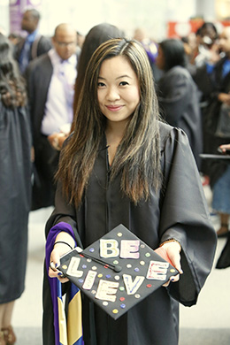 John Jay Student in cap and gown
