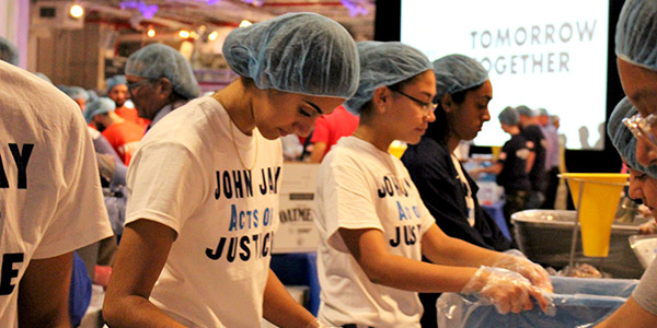 The John Jay community works together during the pack-a-thon