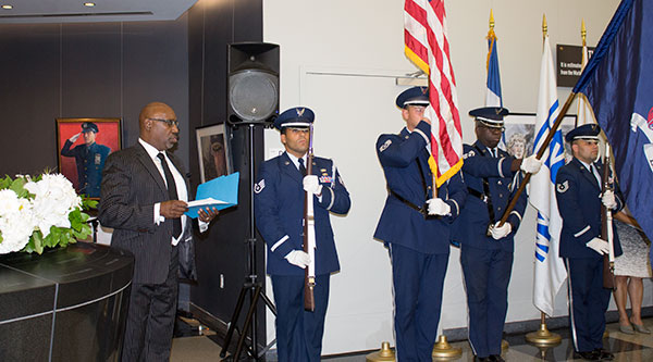 Officers commence the event as Professor Gregory Sheppard sings the National Anthem