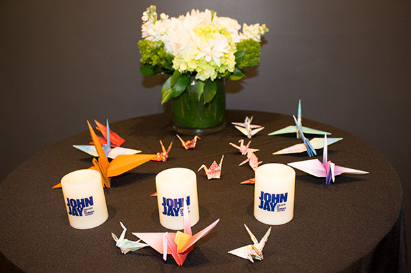 Candles of remembrance and origami cranes of hope