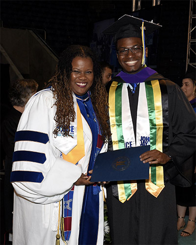 Jevaughn at graduation with Dara Byrne, Associate Provost for Undergraduate Retention and Dean of Undergraduate Studies