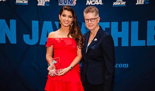 Women's soccer team player, Jaqueline Perez holds her Most Improved Player award