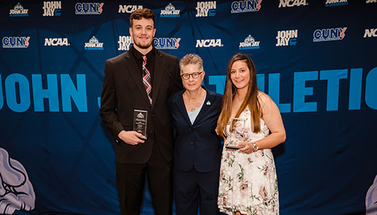 Kashow with the winners of the Athlete of the Year award, Doug Levy and Jessica Barbaria