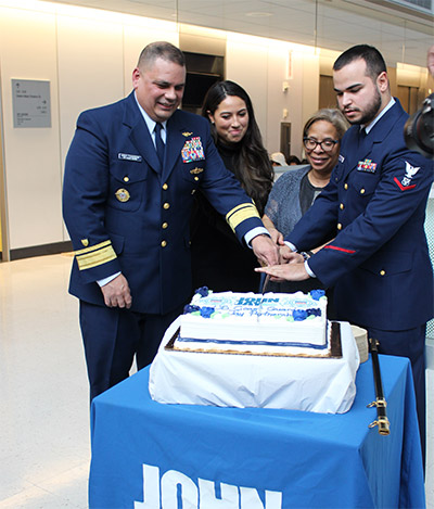 Cutting the cake with an officer's sword
