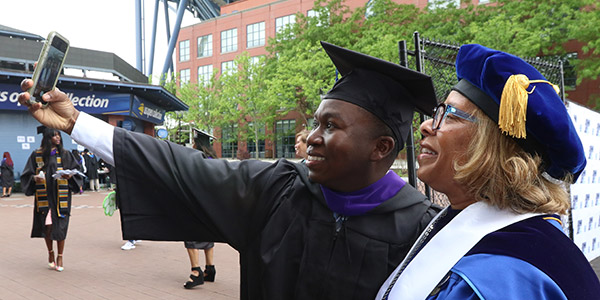 President Karol V. Mason and John Jay graduate