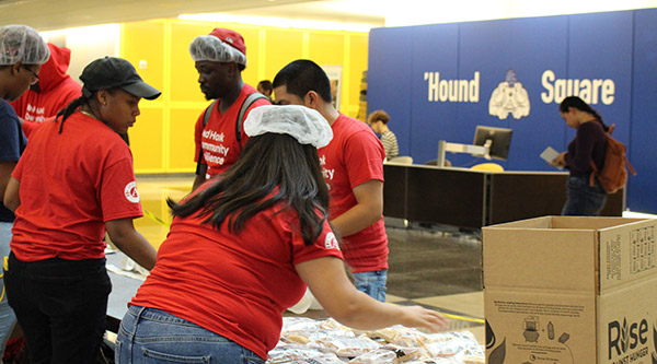 The Rise Against Hunger meal-packing event took place in Hound Square