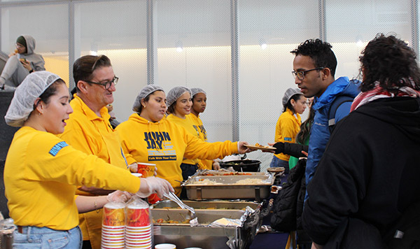 Declan Walsh, Director and COSL, and COSL volunteers provide students with a hot meal