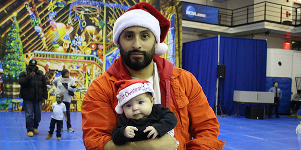 A father and child at the John Jay Annual Children's Holiday Party