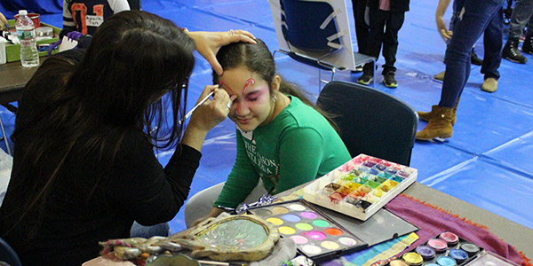 Facepainting at the John Jay Annual Children's Holiday Party