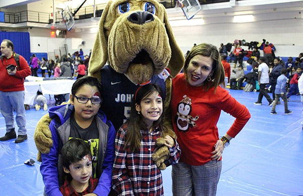 Family with John Jay BLoodhound at the Annual Children's Party