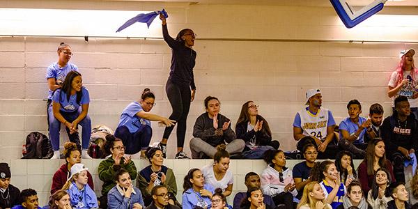 John Jay students cheering on fellow classmates