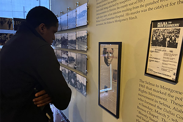 John Francois, looking at a museum exhibit about Jimmy Lee Jackson