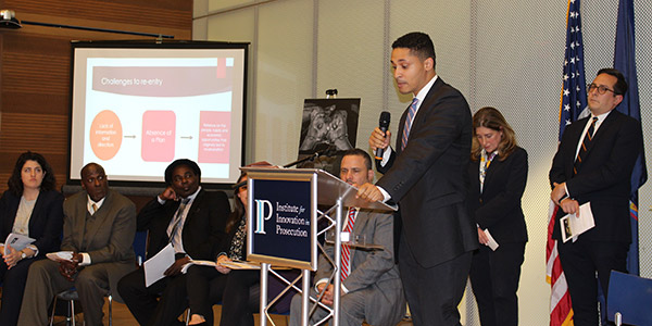 """Xavier Martinez, and his team, presenting their group project on """"The Reentry Navigators Pilot Program"""""""