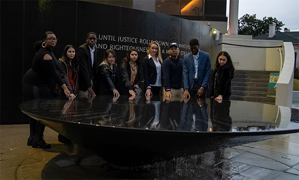 Tyler Johnson '22 (far left) with her fellow honors students at the Civil Rights Memorial in Montgomery, Alabama