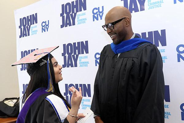 Karamo Brown chatting with valedictorian Jasmine Awad