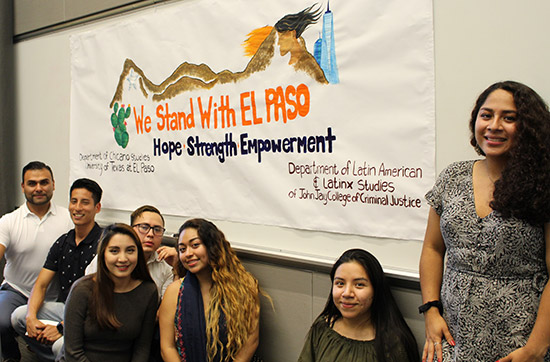 Students pose in front of the poster they helped create in support of El Paso