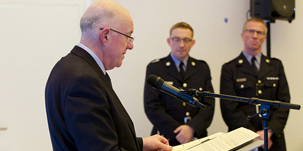 The Minister of Justice and Equality lauding Sergeant Egan and Garda Henderson