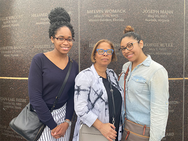 Nairne (left) with President Karol V. Mason (center) and fellow Honors Program student, Giselle Sanchez (right) at The National Memorial for Peace and Justice