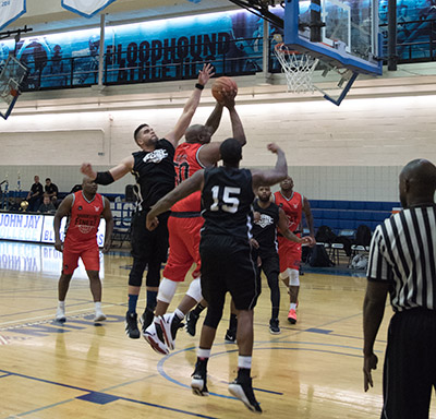 Players trying to block a shot