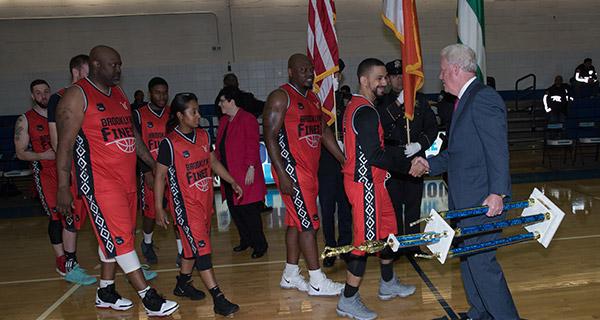 Deputy Commissioner Ganley congratulating Brooklyn Finest on their win